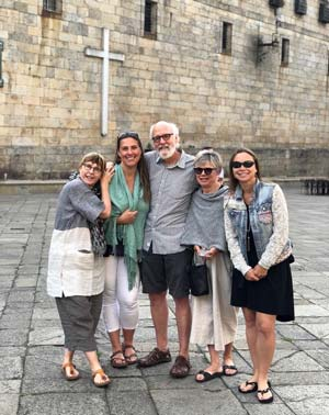 Group of pilgrim on the Quintana Square of the Cathedral of Santiago de Compostela at the end of the Camino de Santiago