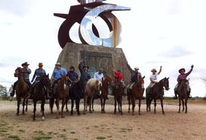 group of horse-riders on the Camino de Santiago arriving in Monte de Gozo